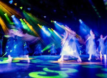 Dancing dancing lit in distorted colourful lighting